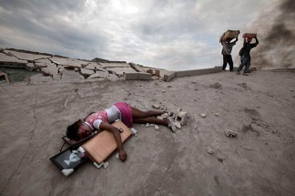 The body of Fabiene Cherisma, 15, who was shot in the head while looting for anything that could be used for survival after the earthquake that struck the captial city of Port au Prince in January 2010. Photo: Paul Hansen